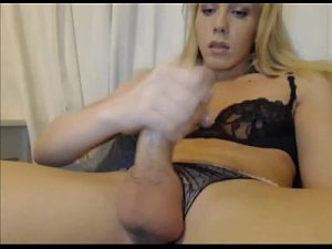 Amazing Blonde Tranny Masturbates Her Oiled Up Dick On Cam